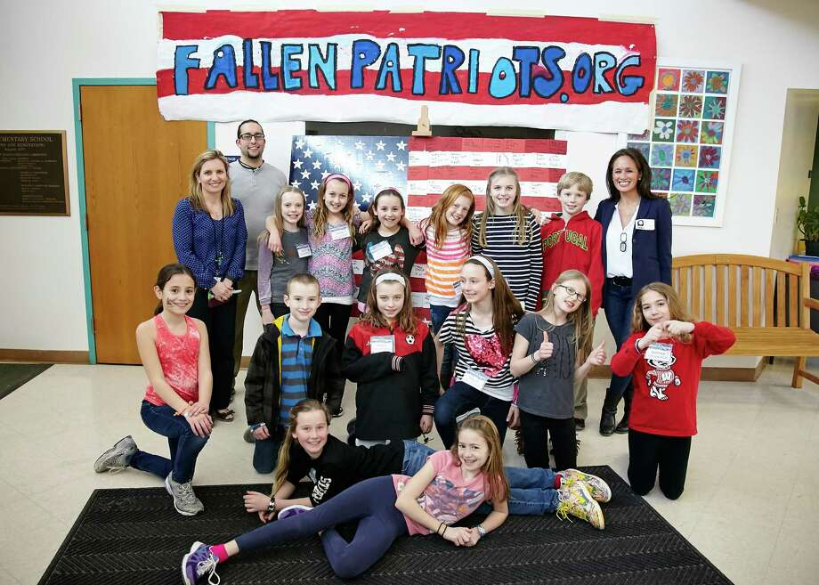 East School students and staff along with Cynthia Kim, Children of Fallen Patriots Foundation co-founder, at the first obstacle course fundraising event. Photo: Contributed Photo / New Canaan News