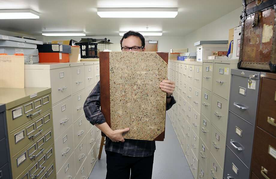 Editor Benjamin Griffin carries a book of archived Sacramento Daily Union newspapers which Mark Twain used to write for, in the Mark Twain Project vault on the UC Berkeley campus in Berkeley, CA on Monday, April 27, 2015. Photo: Michael Short, Special To The Chronicle