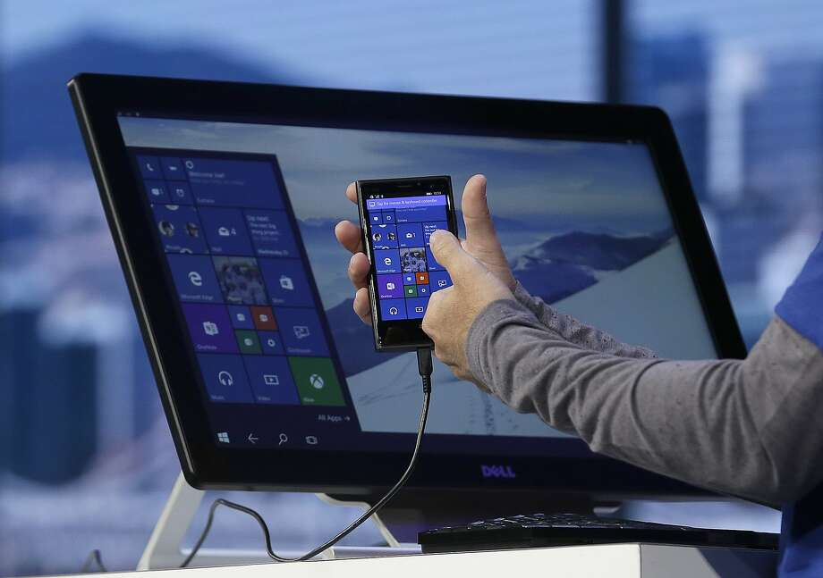 Microsoft executive Joe Belfiore demonstrates apps on a Windows phone at the S.F. conference. Photo: Jeff Chiu, Associated Press