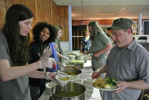 Student volunteers from RPI's Vasudha freshmen living community serve food to patrons of Oakwood Soul Cafe at Oakwood Community Center, April 13, 2015. (Deanna Fox)