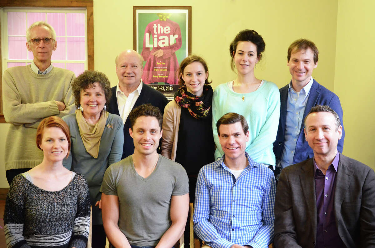 """Playwright David Ives (back left) poses with (l to r.) director Penny Metropulos, cast members Brian Reddy, Rebekah Brockman, Monique Barbee, Rusty Ross; bottom row, Kate MacCluggage, Philippe Bowgen, Aaron Krohn, and Jay Russell before a rehearsal of """"The Liar"""" at Westport Country Playhouse."""