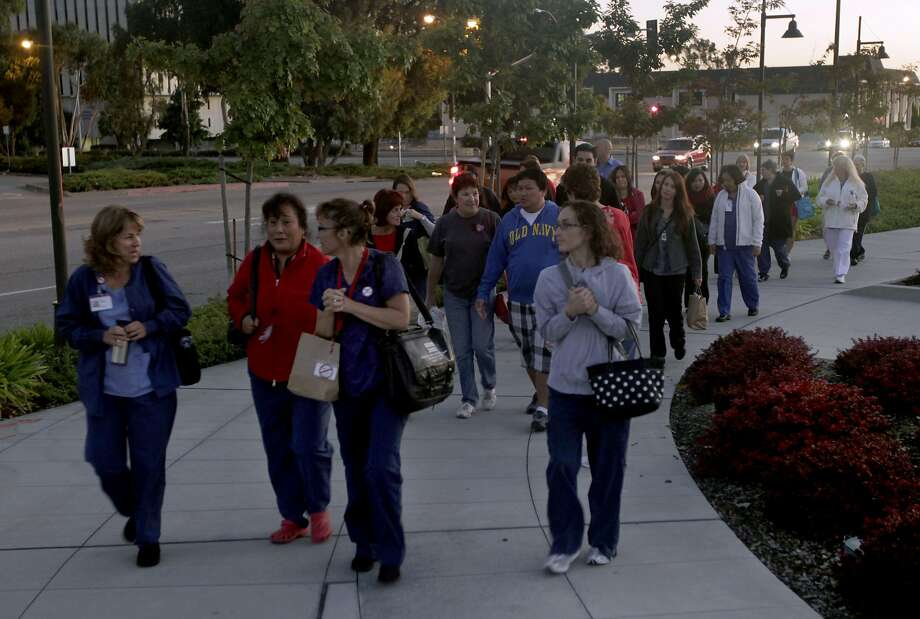 Nurses at Mills-Peninsula Health Services Burlingame and four other Sutter Health hospitals plan a one-day strike on Thursday over contract issues. In this photo, nurses at Mill-Peninsula walk back to work after participating in a one-day strike against Sutter Health in 2011. Photo: Paul Chinn, The Chronicle