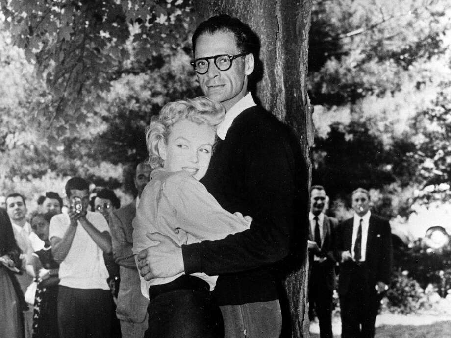 In this June 29, 1956 file photo, actress Marilyn Monroe, left, and playwright Arthur Miller embrace on the lawn of Miller's home in Roxbury, Conn. In 1956, Marilyn Monroe stayed at the Homestead Inn in New Milford, Conn. while she was wooing Arthur Miller. The two would soon marry and live at Miller's Roxbury home. Photo: Contributed Photo / The News-Times Contributed