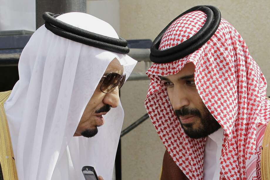 King Salman (left) speaks with his son Prince Mohammed bin Salman, whom he appointed deputy crown prince. Photo: Hassan Ammar, Associated Press