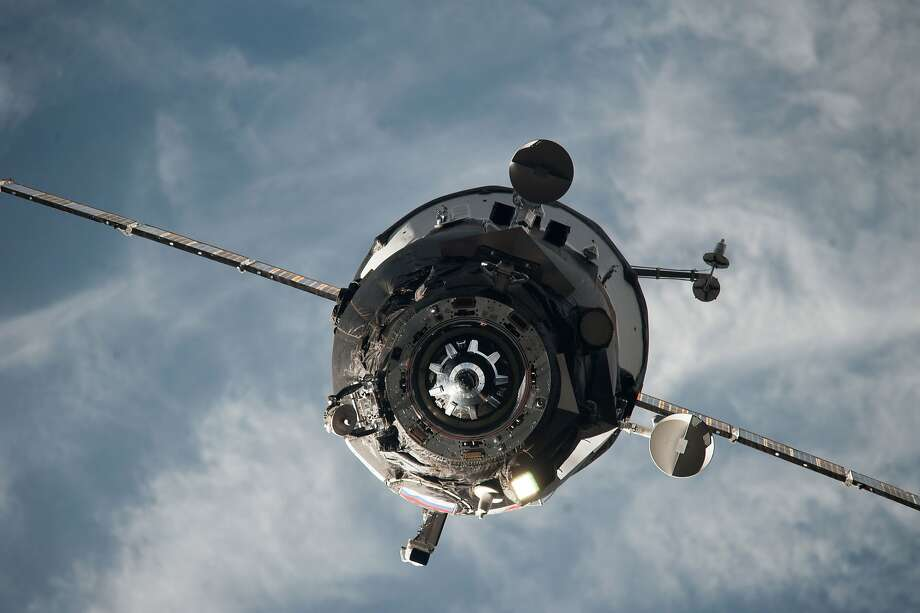 A resupply vehicle approaches the International Space Station in 2014. A Russian spacecraft carrying 3 tons of goods spun out of control on Tuesday. Photo: Associated Press
