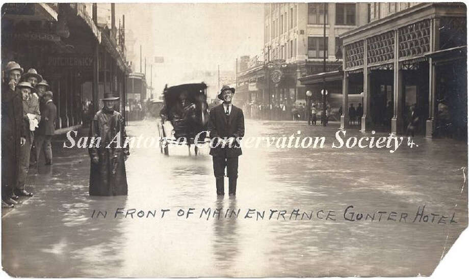 A man stands across from the main entrance to the Gunter Hotel on Houston Street. The Hertzberg clock is visible in the background in front of the Gunter Building. Photo: Courtesy Of San Antonio Conservation Society Foundation