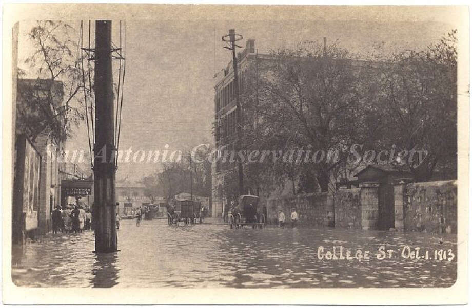 College Street after a flood, looking east. On the left is the Alamo Fire Insurance Building and wall around the Saint Mary's Institute and Church. Photo: Courtesy Of San Antonio Conservation Society Foundation