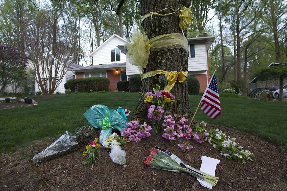 Flowers and ribbons adorn a tree outside the Weinstein home in Rockville, Md. Warren Weinstein was a hostage inadvertently killed by a CIA drone strike. Photo: Jose Luis Magana, Associated Press