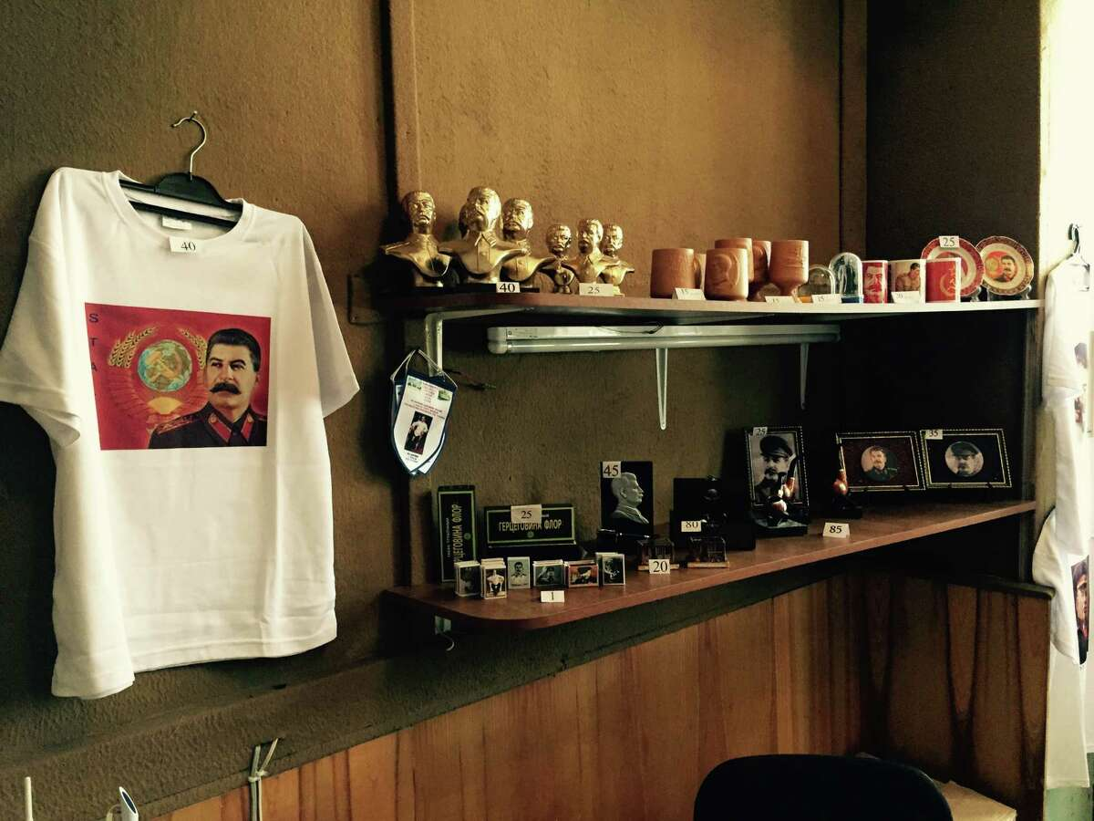 T-shirts, busts, pennants plates, cups and wine bottles embossed with Stalin's image are for sale at the Stalin museum in Gori, Georgia.