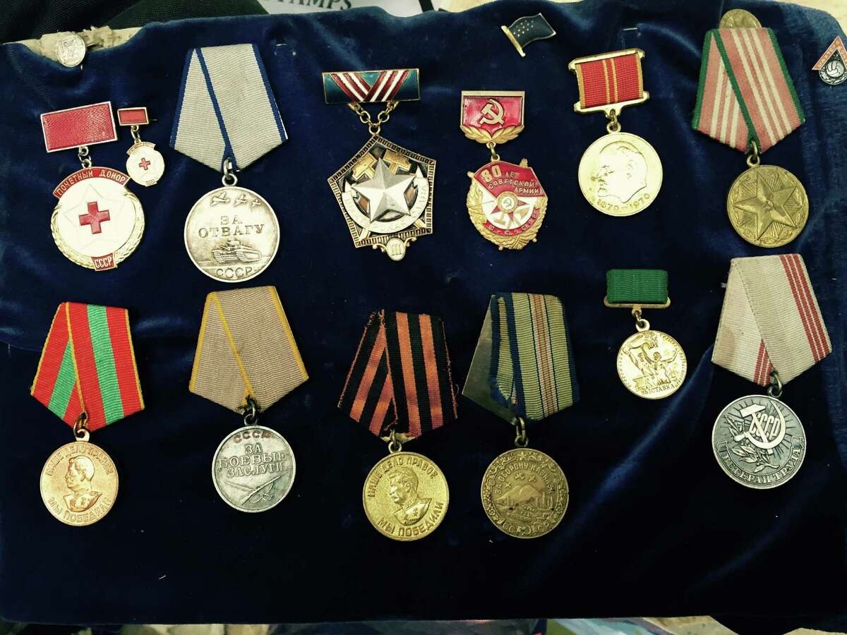 Soviet World War II war medals are for sale at a flea market in Tbilisi, Georgia's capital. The bottom row includes two medals with Stalin's image.