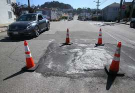 Drivers traveling on Quintara Street have to steer clear of a persistent sinkhole between 18th and 19th avenues in San Francisco, Calif. on Wednesday, April 29, 2015. City crews have filled the hole a number of times in the past two weeks and residents are hoping a permanent fix will be coming soon.
