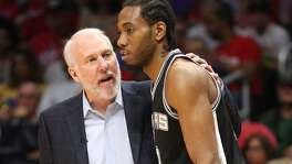 LOS ANGELES, CA - APRIL 28:  Head coach Gregg Popovich and Kawhi Leonard #2 of the San Antonio Spurs confer as they play the Los Angeles Clippers during Game Five of the Western Conference quarterfinals of the 2015 NBA Playoffs at Staples Center on April 28, 2015 in Los Angeles, California.  The Spurs won 111-107.  NOTE TO USER: User expressly acknowledges and agrees that, by downloading and or using this photograph, User is consenting to the terms and conditions of the Getty Images License Agreement.  (Photo by Stephen Dunn/Getty Images)