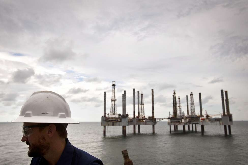 A group of idle rigs is seen behind James Noe, Senior Vice President, General Counsel and Chief Compliance Officer for Hercules Offshore while aboard the Hercules 251 a shallow water drilling rig owned by on Wednesday, Aug. 11, 2010, near Port Fourchon, La.. While shallow offshore drilling is not subject to a federal moratorium, Hercules officials say only two permits have been issued since June, idling activity in their fleet. The company has about 250 employees on idle rigs, with each rig costing the company about $25,000 per day to operate while generating no revenue for the company.( Smiley N. Pool / Chronicle )