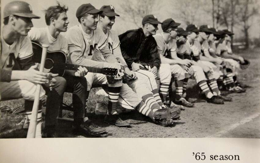 San Antonio Spurs head coach Gregg Popovich , third from left, sits on the bench with the Merrillville High School baseball team in this yearbook photo. Popovich was born in East Chicago but grew up in Merrillville, Indiana. To the left with guitar is his best friend Arlie Pierce. They were both best man at their weddings.