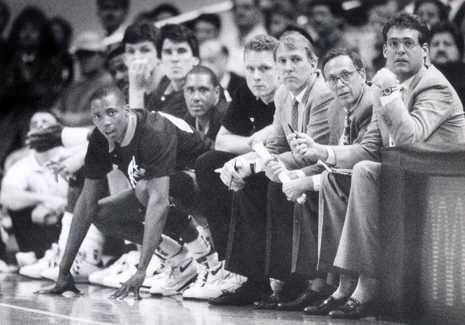 Larry BrownLarry Brown (second from far right, sandwiched between then-assistants Gregg Popovich and R.C. Buford) earned a gold medal as a player in the 1964 Olympics at Tokyo as a feisty point guard. He was assistant coach for the 2000 team that won gold in Sydney in 2000 and head coach of the bronze-medal winning team at Athens in 2004. Photo: Express-News-file Photo