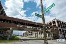 A bridge crosses East Grand Boulevard connecting sections of the abandoned Packard auto assembly plant in Detroit, Michigan, U.S., on Tuesday, April 21, 2015. Arte Express Detroit LLC Chief Executive Officer Fernando Palazuelo bought the Packard Plant in 2013 and is working to restore the site in hopes of bringing jobs and commerce to the neighborhood. Photographer: Bryan Mitchell/Bloomberg