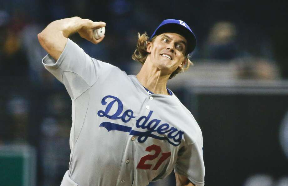 Los Angeles Dodgers starting pitcher Zack Greinke works against the San Diego Padres in the first inning of a baseball game Friday, April 24, 2015 in San Diego.   (AP Photo/Lenny Ignelzi)) Photo: Lenny Ignelzi, Associated Press