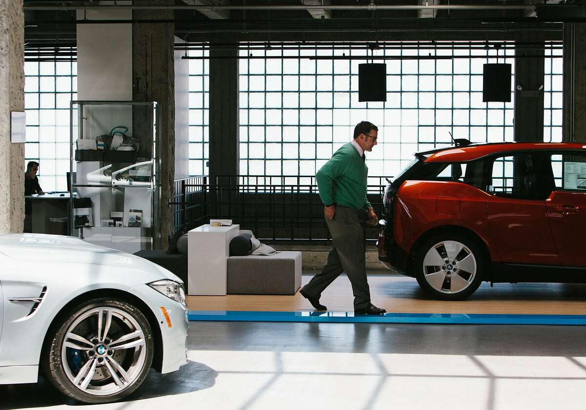 A customer buys a car at the BMW dealership in San Francisco where the new electric i3 is being sold, April 29, 2015. Governor Jerry Brown is announcing a 40 percent reduction in California greenhouse emissions by 2030.3 is being sold, April 29, 2015. Governor Jerry Brown is announcing a 40 percent reduction in California greenhouse emissions by 2030.