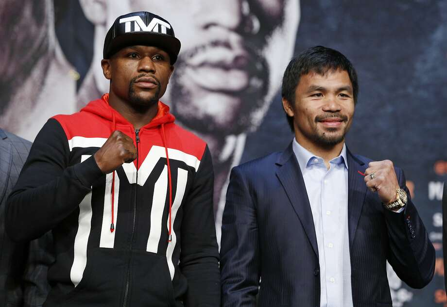 Floyd Mayweather Jr. (left) and Manny Pacquiao mugged for the press conference on Wednesday. They'll square off on Saturday night in Las Vegas. Photo: John Locher, Associated Press