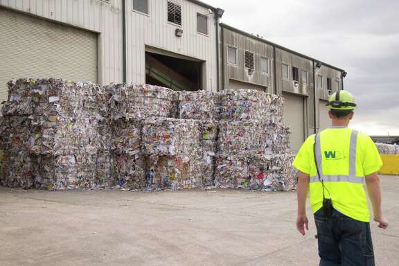 Huge bales of paper are part of the picture at the Waste Manage-ment recycling facility in southwest Houston.