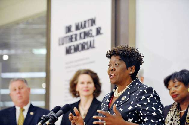"""Assembly Member Crystal Peoples-Stokes addresses those gathered for an event on the Empire State Plaza concourse on Wednesday, April 29, 2015, in Albany, N.Y.  A new glass sculpture titled """"Seeds of Enlightenment,"""" which is the centerpiece of the Dr. Martin Luther King, Jr. Memorial, was unveiled. (Paul Buckowski / Times Union) Photo: PAUL BUCKOWSKI / 00031643A"""