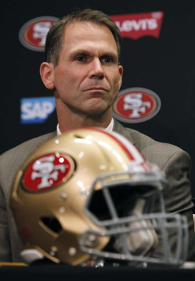 San Francisco 49ers general manager Trent Baalke listens as new head coach Jim Tomsula answers questions during a press conference at Levi's Stadium in Santa Clara, Calif. on Thursday, Jan. 15, 2015. Photo: Paul Chinn, The Chronicle