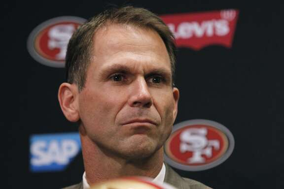 San Francisco 49ers general manager Trent Baalke listens as new head coach Jim Tomsula answers questions during a press conference at Levi's Stadium in Santa Clara, Calif. on Thursday, Jan. 15, 2015.
