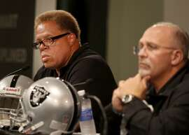 General Manager Reggie McKenzie (left) and coach Tony Sparano listened to a question about McKenzie's future with the team. The Oakland Raiders named Tony Sparano as the team's interim head coach after the firing of Dennis Allen Tuesday September 30, 2014.