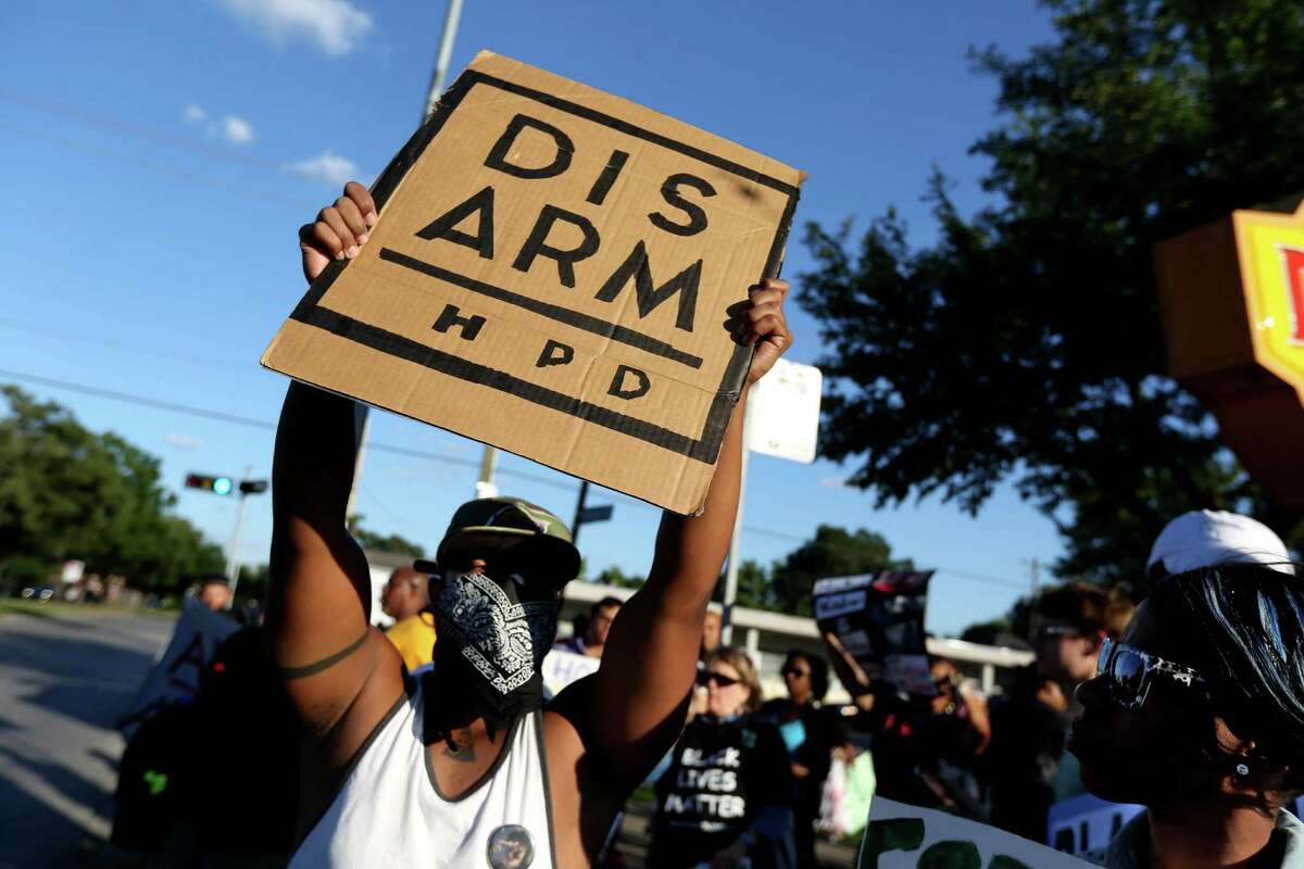 People gather in protest of the recent police violence against citizens and in support of the rioting in Baltimore, Maryland, along the 2300 block of Southmore Blvd. Wednesday, April 29, 2015, in Houston, Texas.