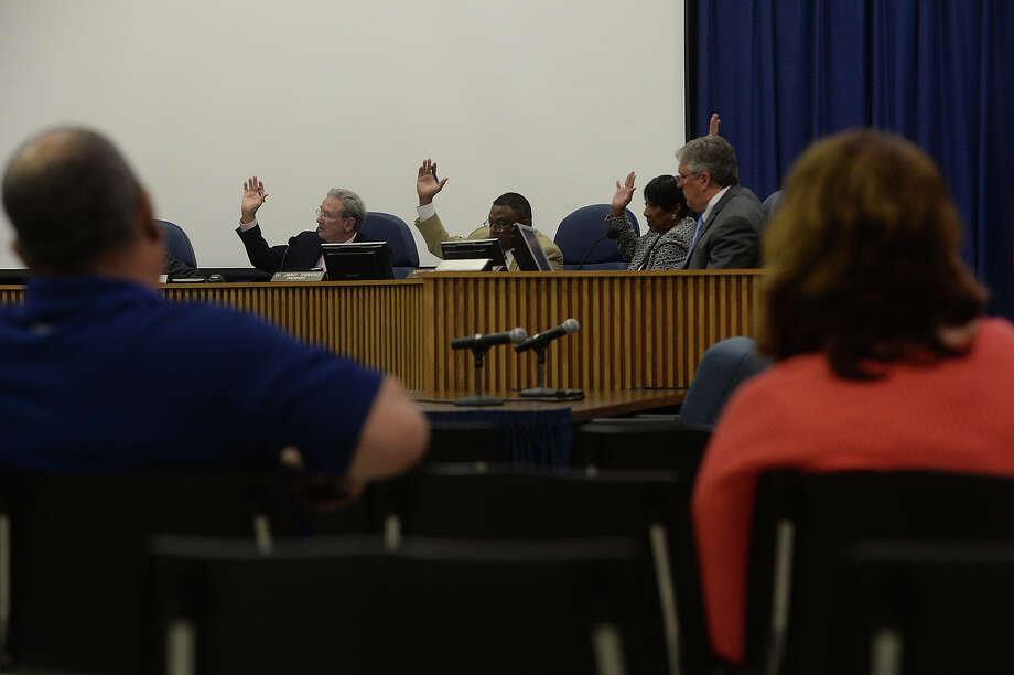 Members of the BISD Board of Managers signal their approval as the board votes on matters relating to contract renewal for professional school employees, including  teachers, staff and other contractors during Wednesday's meeting. The board met in closed session for two hours before emerging to resume the public portion of the meeting. Photo taken Wednesday, April 29, 2015 Kim Brent/The Enterprise Photo: Kim Brent / Beaumont Enterprise
