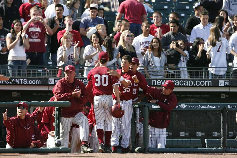 Lowell High School baseball coach John Donohue (left) claps in the AT&T Park dugout on the way to winning the 2007 San Francisco Section title game. The 63-year-old Donohue, who has announced this season will be his last, is enjoying a fruitful final campaign. Photo: Darryl Bush, SFC