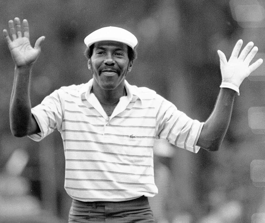 Calvin Peete holds up his arms in thanks to the gallery at the Georgia Pacific-Atlanta Classic in Atlanta as they give him a standing ovation for his victory-clinching birdie on the 18th hole. Peete, the most successful black player on the PGA Tour before the arrival of Tiger Woods, died Wednesday morning. Photo: Joe Holloway  Jr., Associated Press