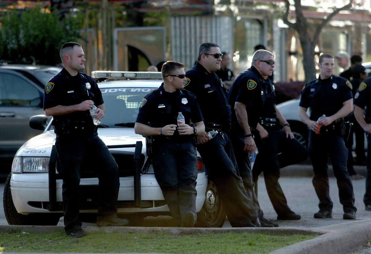 Houston Police Department watches over people gathering in protest of the recent police violence against citizens and in support of the rioting in Baltimore, Maryland, along the 2300 block of Southmore Blvd. Wednesday, April 29, 2015, in Houston, Texas.