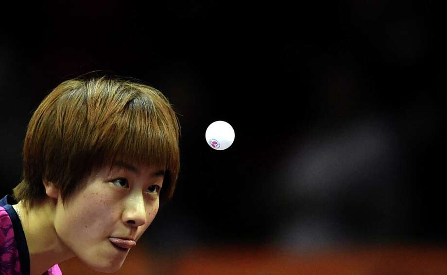 Ding Ning of China serves during her women's singles match against Natalia Partyka of Poland at the 2015 World Table Tennis Championships in Suzhou on April 29, 2015.  Photo: JOHANNES EISELE, AFP / Getty Images / AFP