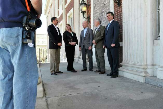 Schenectady City Council candidates, Mike Cuevas, left, and Ann Rigley, second from left, mayoral candidate Roger Hull, third from left, incumbent City Councilman Vince Riggi, fourth from left, and council candidate Tom Verret meet on the steps of City Hall on Wednesday, April 29, 2015, in Schenectady, N.Y.  The event was held for the group to talk with the media about their run for Schenectady City government.   (Paul Buckowski / Times Union) Photo: PAUL BUCKOWSKI / 00031650A