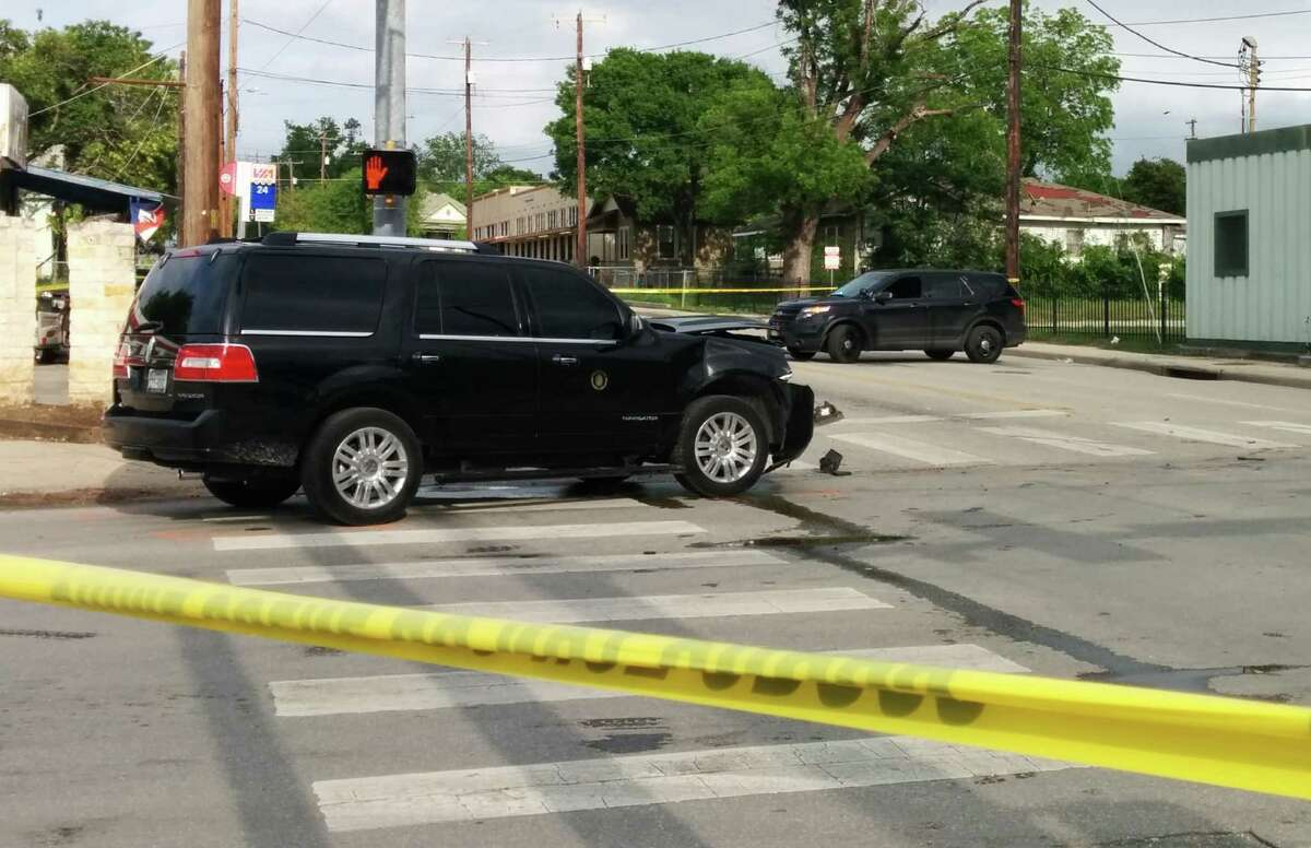 This SUV, driven by a police officer for Mayor Ivy Taylor, sits at East Houston and North Hackberry streets while police investigate the April 18 crash. Its occupants weren't injured.
