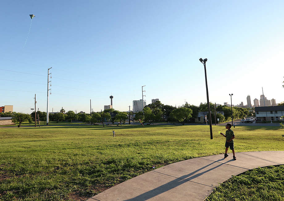 A boy flies a kite at Lockwood Park in the Dignowity Historical District, Wednesday, April 29, 2015. The neighborhood is undergoing gentrification. The San Antonio City Council got a list of recommendations on how to address gentrification during a B session meeting Wednesday. Photo: JERRY LARA, San Antonio Express-News / © 2015 San Antonio Express-News