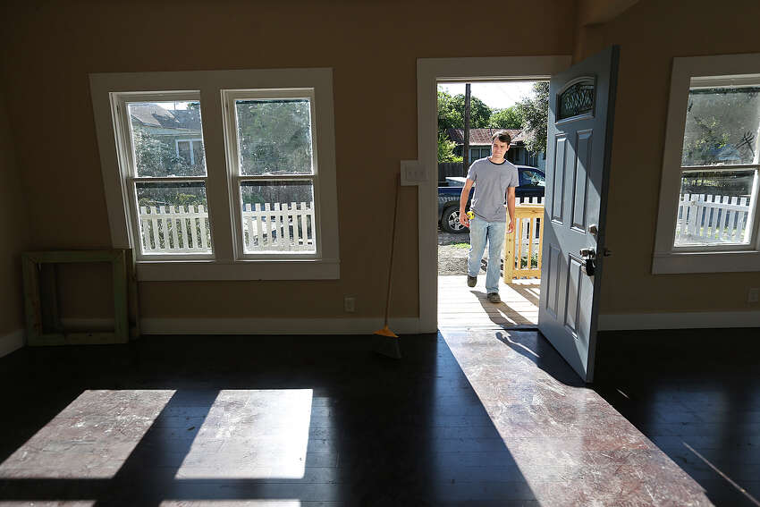 Caleb Macias works on renovating a house at 306 Willow in the Dignowity Historical District, Wednesday, April 29, 2015. Macias bought the house in last August and hope to sell it once work is done. The neighborhood is undergoing gentrification. The San Antonio City Council got a list of recommendations on how to address gentrification during a B session meeting Wednesday.