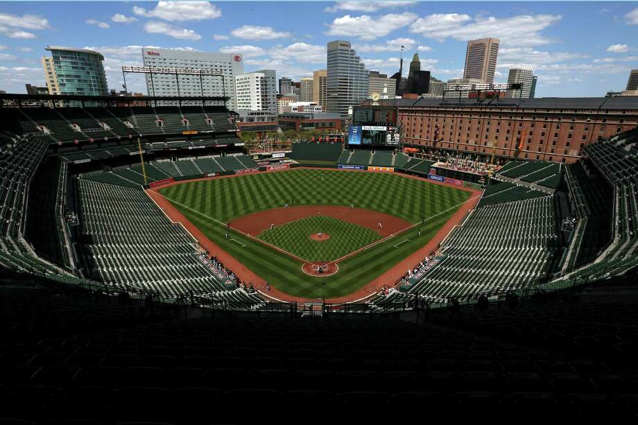 BALTIMORE, MD - APRIL 29: Starting pitcher Ubaldo Jimenez #31 of the Baltimore Orioles throws the first pitch of the game to Adam Eaton #0 of the Chicago White Sox in the first inning at an empty Oriole Park at Camden Yards on April 29, 2015 in Baltimore, Maryland. Due to unrest in relation to the arrest and death of Freddie Gray, the two teams played in a stadium closed to the public. Gray, 25, was arrested for possessing a switch blade knife April 12 outside the Gilmor Houses housing project on Baltimore's west side. According to his attorney, Gray died a week later in the hospital from a severe spinal cord injury he received while in police custody. (Photo by Patrick Smith/Getty Images) Photo: Patrick Smith, Staff / 2015 Getty Images