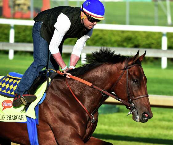 Morning Line favorite for this year's Kentucky Derby American Pharaoh goes out for exercise with rider George Alvarez Wednesday morning at Churchill Downs April 29, 2015, in Louisville, Ky.  Saturday is the 141st running of The Kentucky Derby.       (Skip Dickstein/Times Union) Photo: SKIP DICKSTEIN