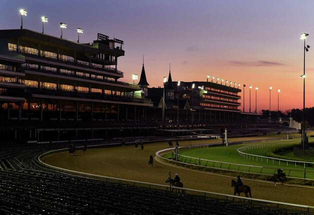 Horses work as the sun comes up Wednesday morning at Churchill Downs April 29, 2015 in Louisville, Ky.  Saturday is the 141st running of The Kentucky Derby.       (Skip Dickstein/Times Union) Photo: SKIP DICKSTEIN