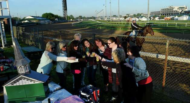 The Derby party has started for a group of women from Louisville on the backstretch Wednesday morning at Churchill Downs April 29, 2015 in Louisville, Ky.  Saturday is the 141st running of The Kentucky Derby.       (Skip Dickstein/Times Union) Photo: SKIP DICKSTEIN