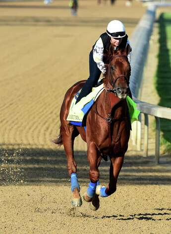 Second favorite the this year's Kentucky Derby Dortmund goes out for exercise with rider Dana Barnes Wednesday morning at Churchill Downs April 29, 2015, in Louisville, Ky.  Saturday is the 141st running of The Kentucky Derby.       (Skip Dickstein/Times Union) Photo: SKIP DICKSTEIN