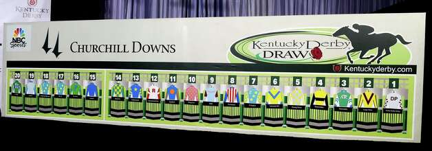 The post positions for the 141st Kentucky Derby are drawn and put on the board at the Post Position Draw ceremony held Wednesday April 29, 2015 at Churchill Downs in Louisville, Kentucky.      (Skip Dickstein/Times Union) Photo: SKIP DICKSTEIN