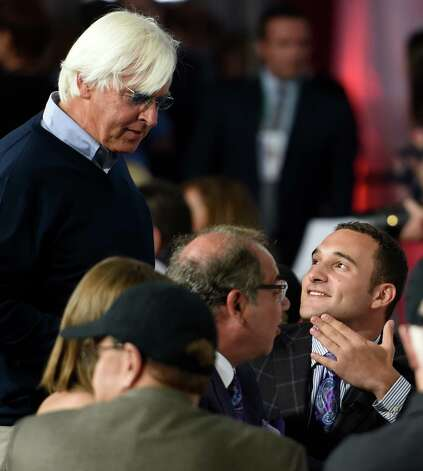 Trainer Bob Baffert, left has the 5-2 morning line favorite American Pharaoh speaks with owners Ahmed  and Justin Zayat, center and right, at the Post Position Draw ceremony held Wednesday April 29, 2015 at Churchill Downs in Louisville, Kentucky.      (Skip Dickstein/Times Union) Photo: SKIP DICKSTEIN