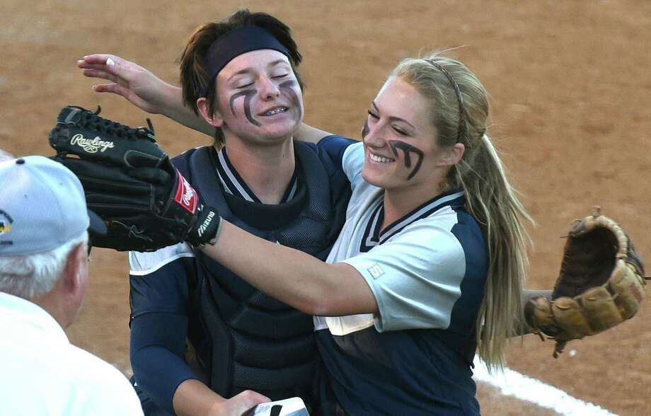 Smithson Valley pitcher Regan Mergele (right) embraces catcher Katherine Matthys after getting out of a third-inning jam against Churchill in their Class 6A bidistrict playoff matchup at the SAISD Complex. Photo: Billy Calzada / San Antonio Express-News / San Antonio Express-News