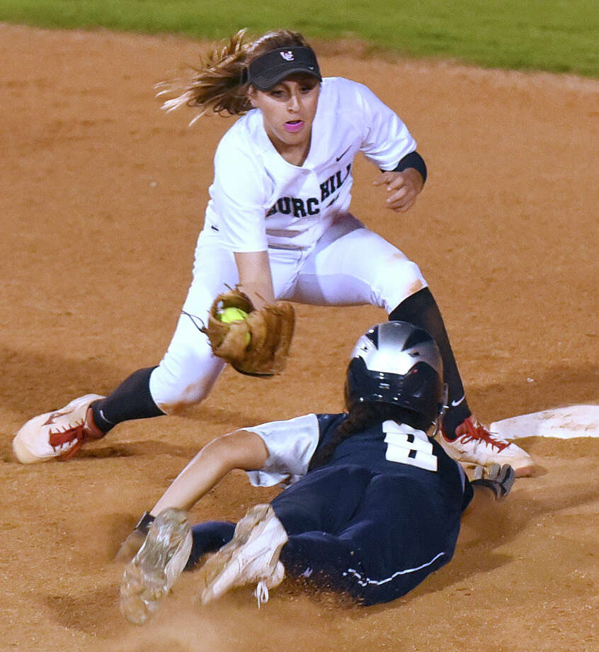 Churchill shortstop Abby White tags out Monique McElroy of Smithson Valley as she attempts to steal second base during UIL Class 6A first-round high school playoffs action at the SAISD complex on Wednesday, April 29, 2015. Photo: Billy Calzada, Staff / San Antonio Express-News / San Antonio Express-News