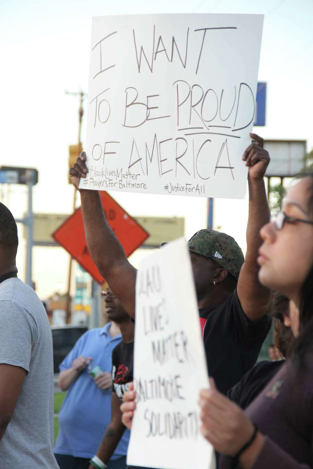 Protesters in San Antonio took to Perrin Beitel and Loop 410 on Wednesday evening to show support and solidarity in the wake of the death of Freddie Gray, who reportedly died of a spinal injury while in Baltimore police custody.