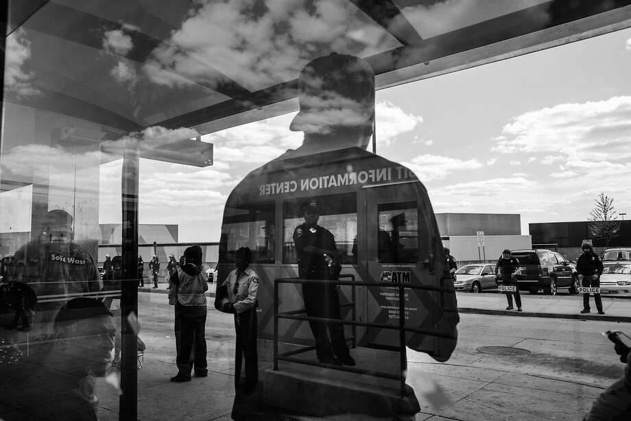 People wait for the bus at the Mondawmin Station while police secure Mondawmin Mall on April 29, 2015 in Baltimore, Maryland. Mondawmin Mall was looted by people Monday afternoon, the same day as the funeral for Freddie Gray. Gray, 25, was arrested for possessing a switch blade knife April 12 outside the Gilmor Houses housing project on Baltimore's west side. According to his attorney, Gray died a week later in the hospital from a severe spinal cord injury he received while in police custody. Photo: Andrew Burton, Getty Images