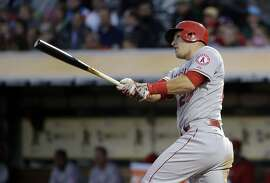 Los Angeles Angels' Mike Trout hits a solo-home run against the Oakland Athletics during the third inning of a baseball game Wednesday, April 29, 2015, in Oakland, Calif. (AP Photo/Marcio Jose Sanchez)